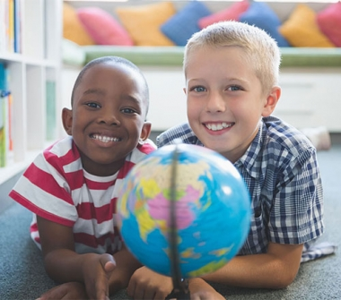 Two students with a globe
