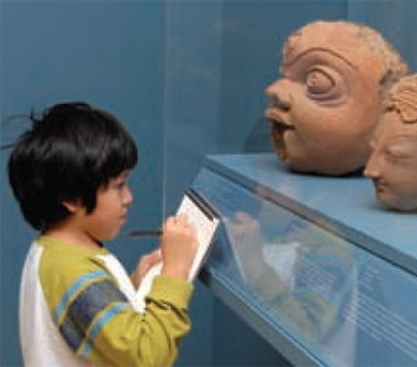A young child looks at an exhibit in Asia Society's museum.
