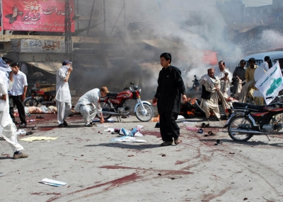 Pakistani Shiite Muslim men help injured blast victims at the site of a suicide bomb attack in Quetta on September 3, 2010. (Banaras Khan/AFP/Getty Images)