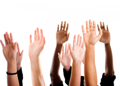 Students raising their hands. (urbancow/iStockPhoto)