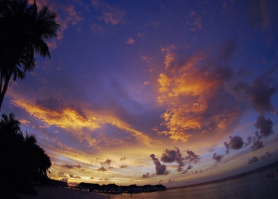 The setting sun casts purple and gold hues across the sky in Maldives on May 2, 2015. (michibanban/Flickr)
