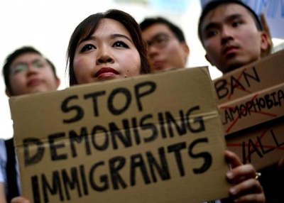 Malaysian activists hold placards during a protest against U.S. President Donald Trump's immigration order outside the U.S. Embassy in Kuala Lumpur on February 3, 2017. (Manan Vatsyayana/AFP/Getty Images)