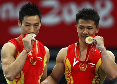 Chinese gymnasts pose with their medals at the 2008 Olympic Games in Beijing. (Jonathan Ferrey/Getty)