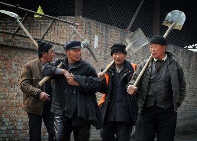 Chinese migrant workers leave their factory construction site for a lunch break in Beijing on March 16, 2012. (Mark Ralston/AFP/Getty Images)
