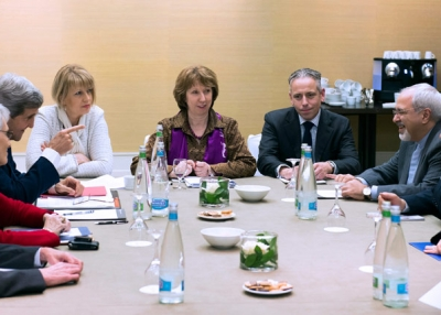 U.S. Secretary of State John Kerry (2nd L), European Union foreign policy chief Catherine Ashton (C ) and Iranian Foreign Minister Mohammad Javad Zarif (2ndR) wait prior to a meeting on November 9, 2013, on the third day of talks on Iran's nuclear program at the Intercontinental Hotel in Geneva Switzerland. (Jean-Christophe Bott/AFP/Getty Images)
