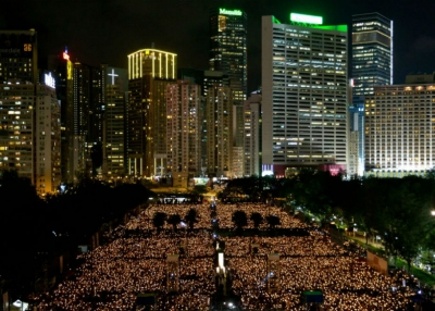 People take part in a candlelight vigil in Hong Kong on June 4, 2015, to mark the crackdown on the pro-democracy movement in Beijing's Tiananmen Square in 1989. (Dale de la Rey/AFP/Getty Images)