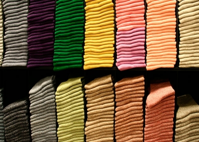Stacks of colorful basics at Uniqlo. (Kiwi He/Flickr)