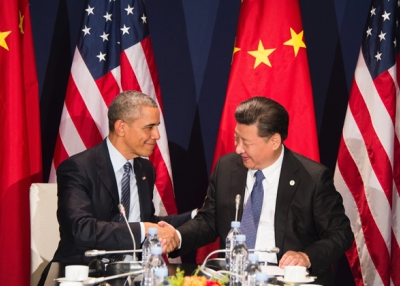 U.S. President Barack Obama (L) shakes hands with Chinese President Xi Jinping during a bilateral meeting ahead of the opening of the UN conference on climate change COP21 on November 30, 2015. (Jim Watson/AFP/Getty Images)