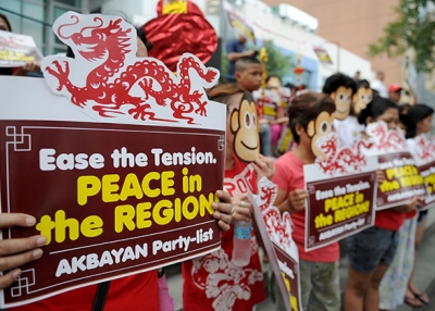 Activists wearing monkey masks display placards during a rally against Beijing's island-building in the South China Sea, ahead of the year of the monkey at the Chinese consulate in Manila on February 5, 2016. (Jay Directo/AFP/Getty Images)
