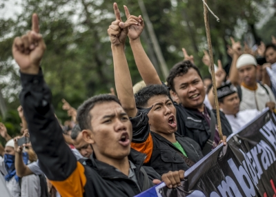 Indonesian Muslims gesture and shout slogans during an anti-government rally in Jakarta on July 18, 2017