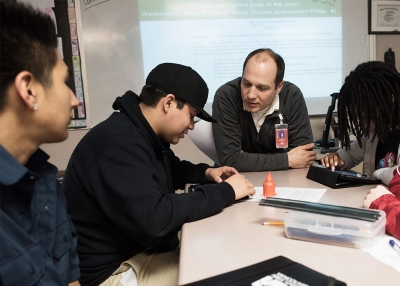 An educator works with a group of students.