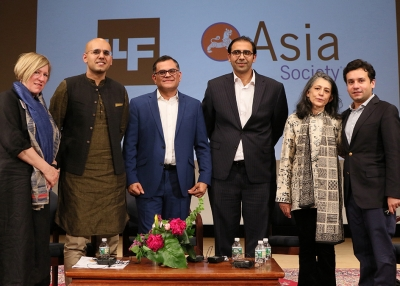 Panelists and organizers pose on stage at Lahore Literary Festival New York 2018
