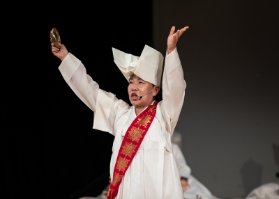 Shaman Park Miouk on stage during Ssitkimkut: The Korean Shaman Ritual of the Dead at Asia Society New York