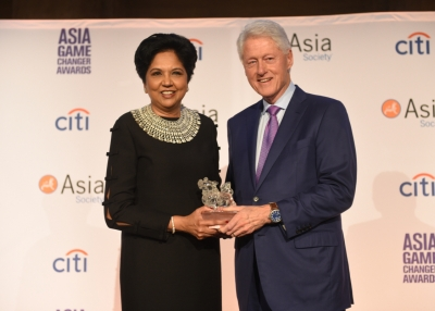 Indra Nooyi and Bill Clinton