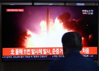 A man in South Korea watches a North Korean missile launch