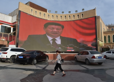 A video billboard of Xi Jinping overlooks Kashgar, China