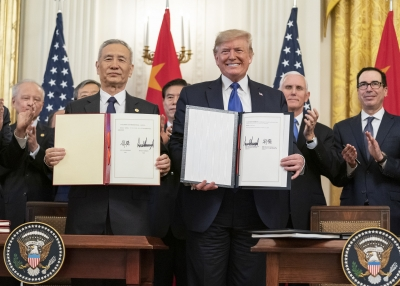 President Donald J. Trump and Chinese Vice Premier Liu He sign the U.S.-China Phase One Trade Agreement