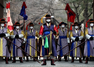 South Korean imperial guards conducting a re-enactment with face masks due to the coronavirus.