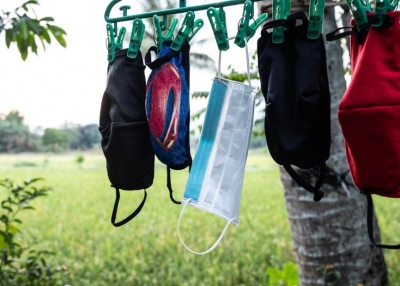 Nurse April Abrias' facemasks are hung out to dry after being washed so they can be reused