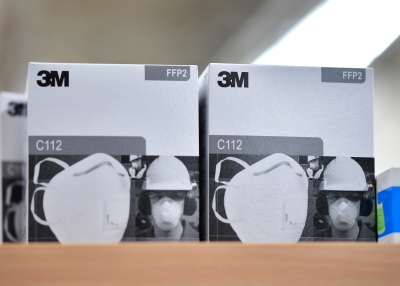Boxes of 3M face basks on a table in Germany