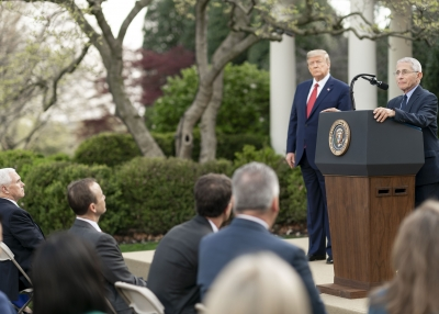 U.S. President Donald Trump listens as Director of the National Institute of Allergy and Infectious Diseases Dr. Anthony S. Fauci delivers remarks during a coronavirus update briefing Sunday, March 29, 2020, in the Rose Garden at the White House