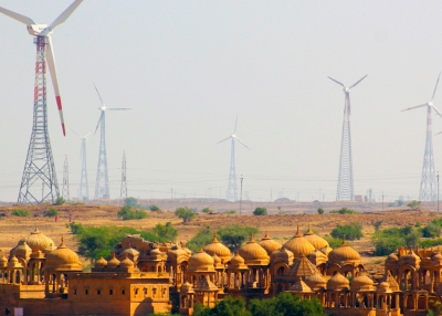 Kohli & Suckling - A_Wind_Energy_farm_and_the_Cenotaphs_Jaisalmer_Rajasthan_India - Wikimedia