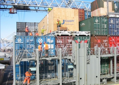 Workers on a container ship in Rotterdam