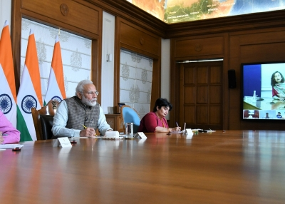 Indian Prime Minister Narendra Modi holds a video conference with journalists on tackling coronavirus in New Delhi on March 24, 2020