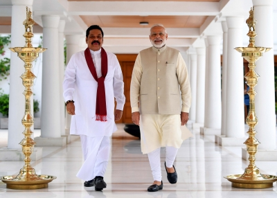 Sri Lankan Prime Minister Mahinda Rajapaksa walks with Indian Prime Minister Narendra Modi on September 12, 2018 in New Delhi, India.