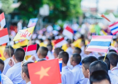 Varrall - ASEAN Day students and flags - AdobeStock
