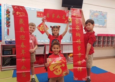 First-graders holding the Chinese Spring couplet on the Lunar New Year day