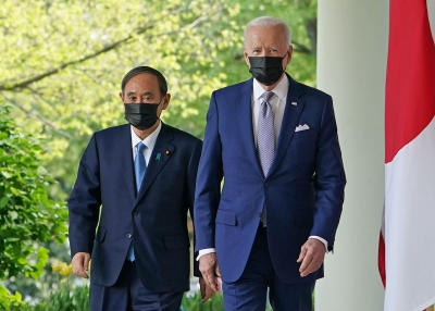 President Joe Biden and Japan's Prime Minister Yoshihide Suga walk through the Colonnade to take part in a joint press conference at the White House