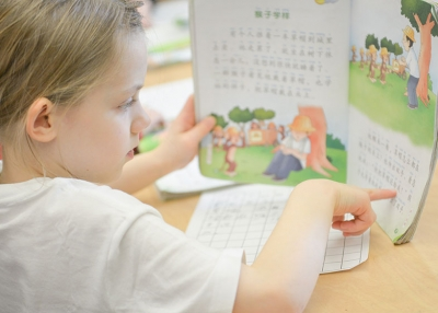A student reads a Chinese textbook