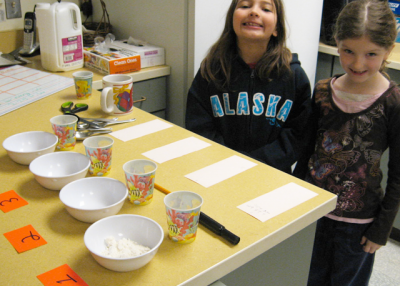 Children at the John Stanford School take part in an experiment, courtesy of Latona School Associates. (LSA)