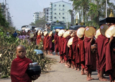Buddhist monks make their way through the streets to collect offerings in Yangon on May 8, 2009, in the aftermath of Cyclone Nargis. (Hla Hla Htay/AFP/Getty Images)