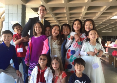 Chris, pictured above with students, in his current role as Chinese program director and elementary school principal at International School of the Peninsula in Palo Alto, CA.
