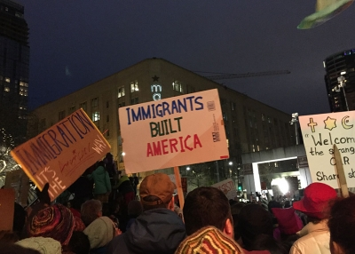 "A sign that reads ""Immigrants Built America"" at a rally in Seattle, Washington."