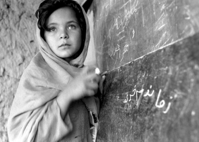An Afghan girl in school. (Roger Lemoyne/UN)