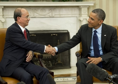 Myanmar's President Thein Sein shakes hands with U.S. President Barack Obama during meetings at the White House in May 2013. (Saul Loeb/AFP/Getty Images)