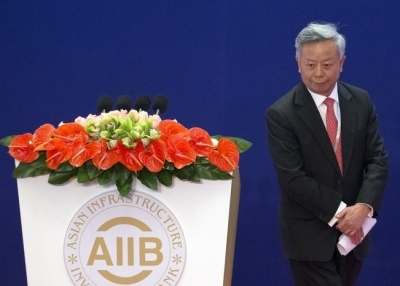 Jin Liqun, the first president of the Asian Infrastructure Investment Bank (AIIB), leaves the podium during the opening ceremony of the AIIB in Beijing on January 16, 2016. (MARK SCHIEFELBEIN/AFP/Getty Images)