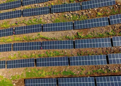 Chinese workers check solar photovoltaic modules on a hillside in a village in Chuzhou, in eastern China's Anhui province on April 13, 2017. (STR/AFP/Getty Images)