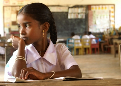 A girl studies in a classroom in Sri Lanka.