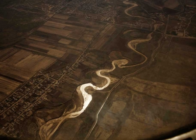 "Overhead view of the Syr Darya river in Uzbekistan, with an irrigation canal on the right. From Carolyn Drake's ""Two Rivers."" (Carolyn Drake)"