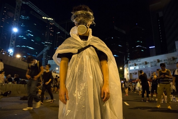 A pro-democracy protestor stands before a photographer in Hong Kong as thousands of others remain on the streets of the city after a weekend of protests. (Paula Bronstein/Getty Images)
