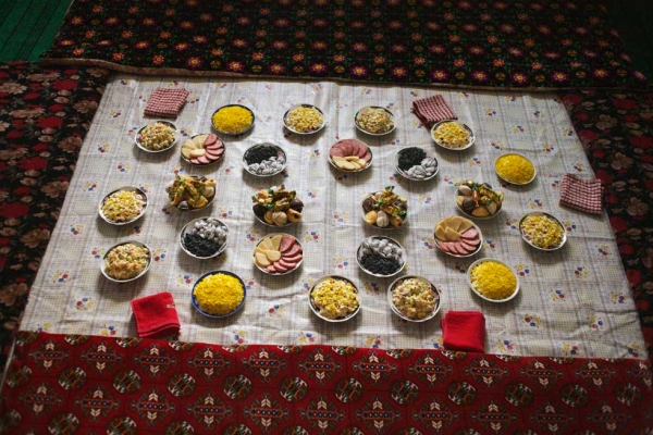 "Food about to be served at a birthday party in Uzbekistan. From ""Two Rivers."" (Carolyn Drake)"