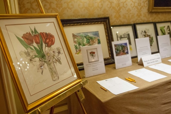 Silent auction items on display. In the foreground, a painting by Senator Dianne Feinstein. (Drew Altizer/Asia Society)