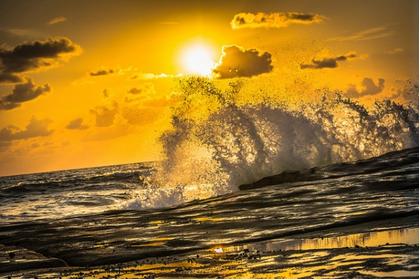 The waves of Shelly Beach glisten under the sunrise in Queensland, Australia on October 28, 2013. (Sam Pertherbridge/Flickr)
