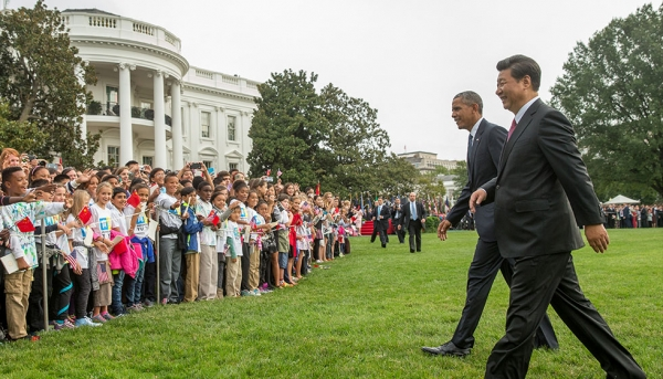 Yu Ying students wait on the South Lawn of the White House to meet President Xi Jinping and President Obama while attending President Xi's welcome ceremony. (Evan Vucci/Associated Press)