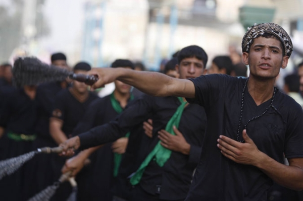 Shiite Muslim pilgrims self-flagellate as they gather at Imam Musa al-Kadhim Mosque in Northern Baghdad July 7th.