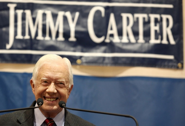 Former President Jimmy Carter smiles at the crowd during his 28th annual town hall meeting in Atlanta, Georgia on September 16, 2009.
